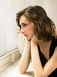 42-15969694.jpg depression woman looking out window
